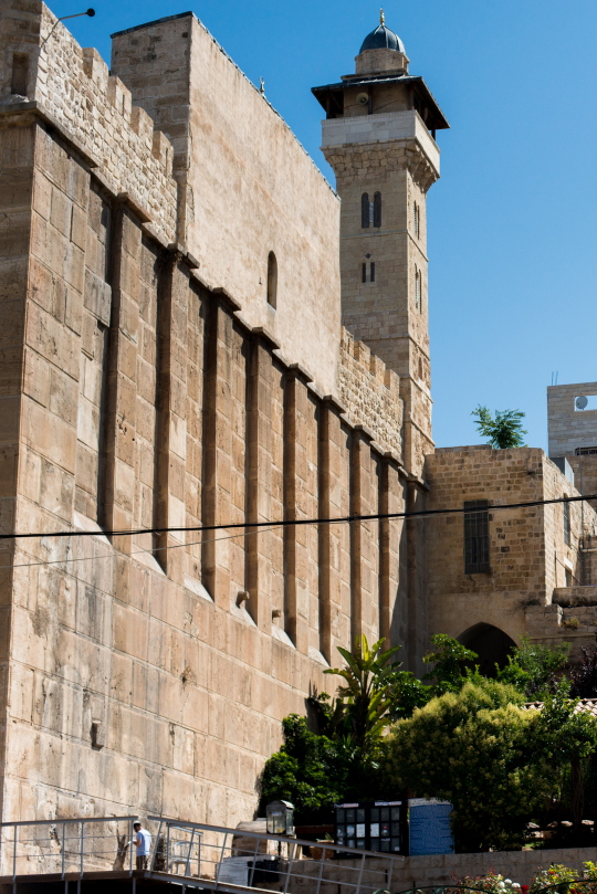 Man prays at base of Ma'arat HaMachpelah synagogue connected to the Ibrahami Mosque on the location of the Cave of the Patriarchs in H2.