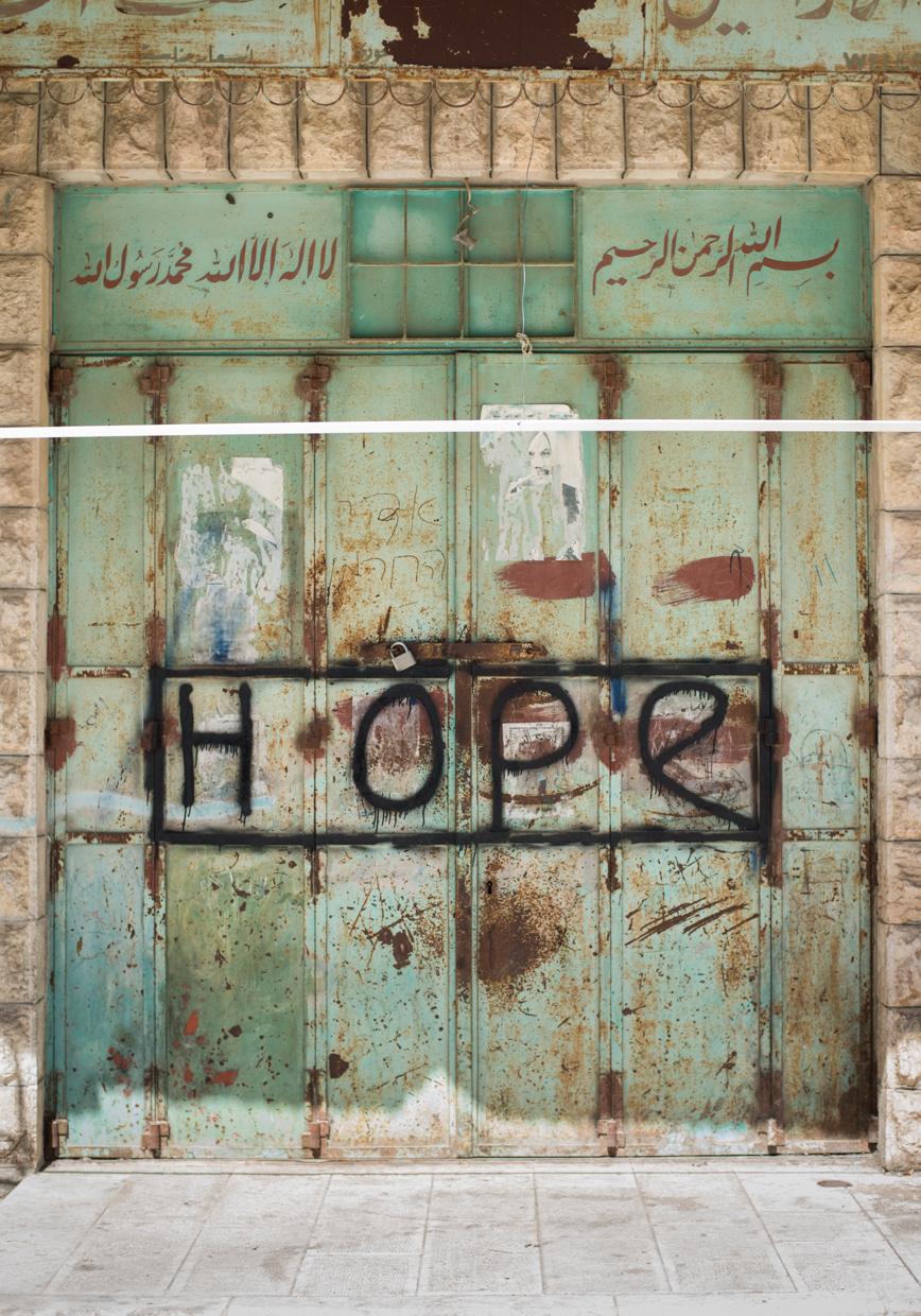 "HOPE"" - Hebron (H2), Palestine, 2016    LISTEN    ""The most important thing is that we must not give up hope. People ask us, I mean, how do you hope in this hopeless situation. My answer is that, you know, as a Christian, my hope does not come from a human being, does not come from a state, or does not come from, from a powerful quote-unquote Christian cities and Christian countries. My hope comes only from our Lord Jesus Christ. And this is the thing that keeps us running in this, in this land. Otherwise we would have left this land long time ago."""
