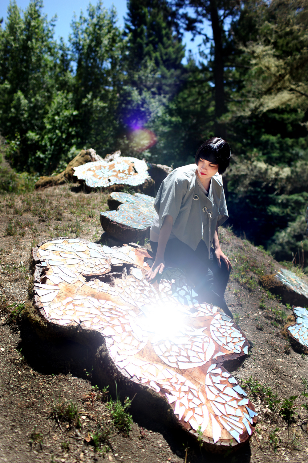 Artist Drue Kataoka with her piece After the Celestial Axe, at Djerassi in Woodside, July 12, 2013.
