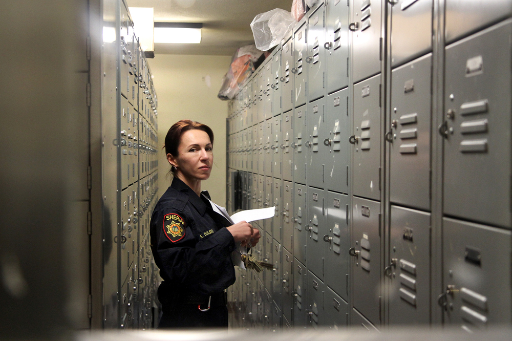 A prison guard looks up from the locker room at the San Mateo County Jail, on Sept. 18, 2012.