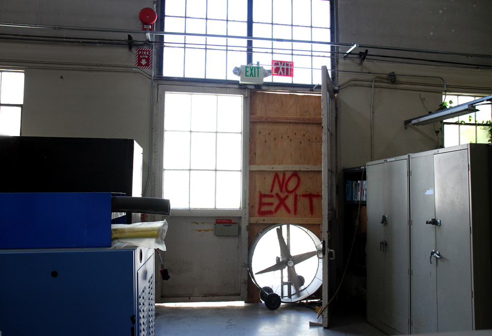 Inside Building 10, a side of a wall is carved to fit a fan, ventilating TCE fumes.