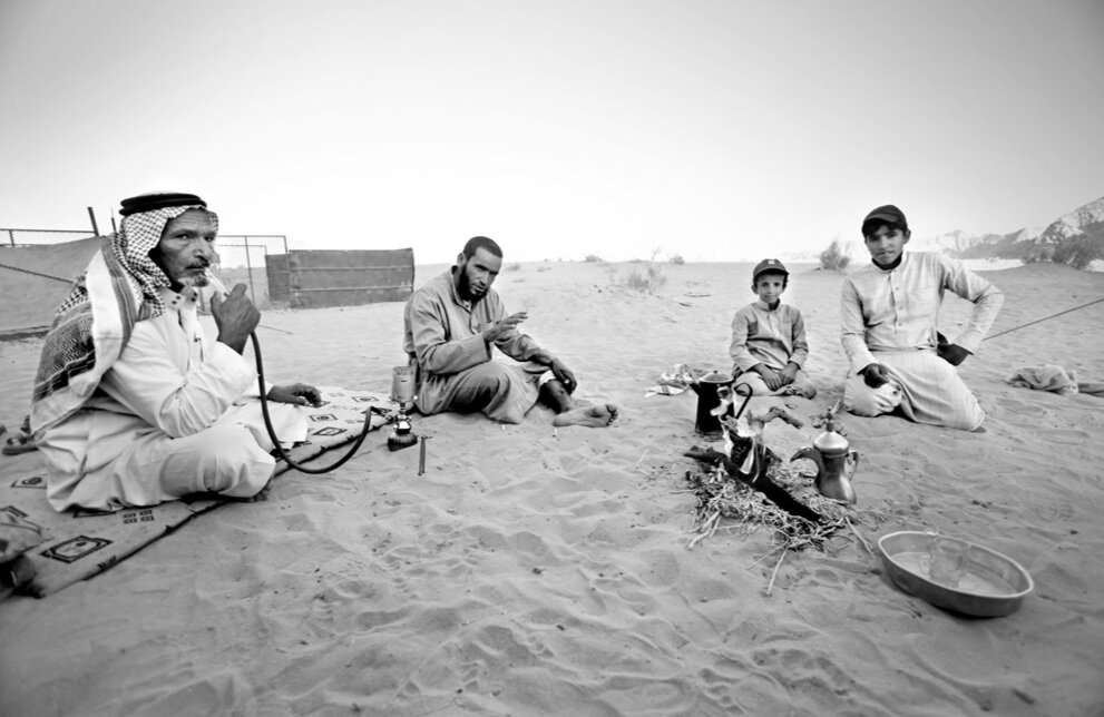 A group of Saudi Arabian men visit a Beduin family in Wadi Rum, Jordan, on Jul 4, 2010.