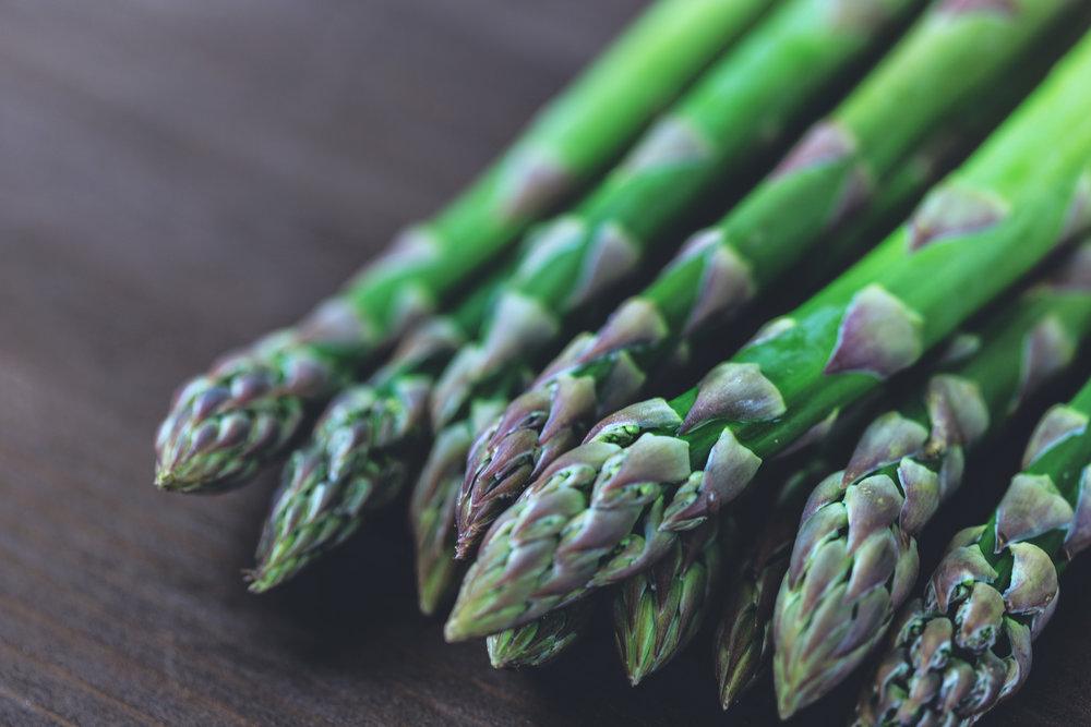 Fresh green asparagus on table
