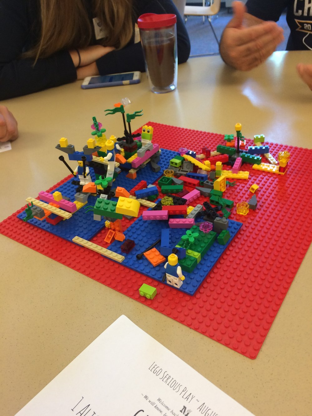 Discussing what collaboration means using LEGO bricks as metaphors.