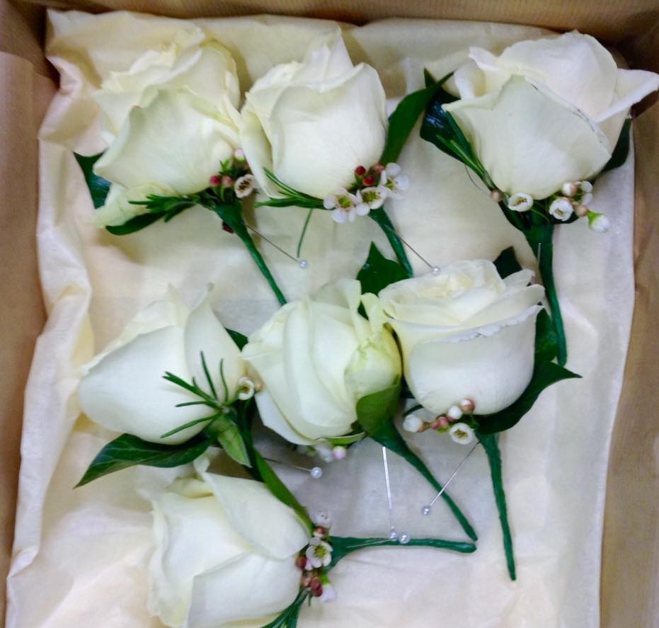 Claudia buttonholes winter rose.jpg