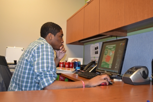 Besson designing advertisements in the revamped Career Services Office
