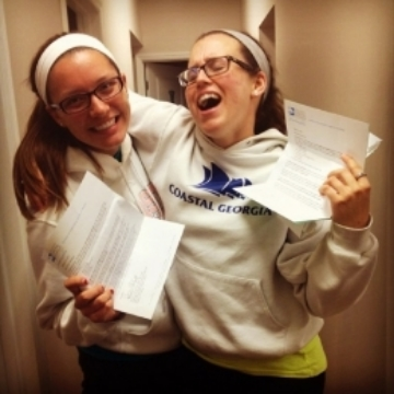 Holly hammer and Kansas Robison receiving their Nursing acceptance letter