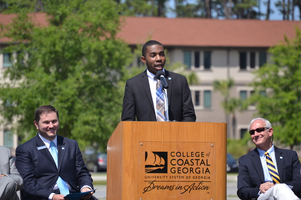 Student government president Robert Marcus Mydell shares remarks as the groundbreaking of Mariner Village on May 4.   The Crow's Nest