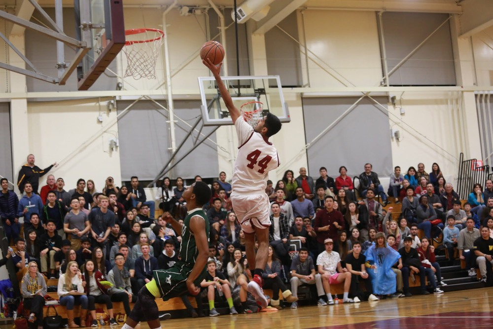 Senior Ajaypal Singh soars to the basket in a home game against Homestead.