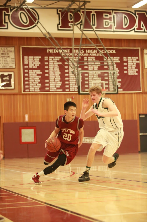 Senior Ethan Shen (20) drives the ball during the first quarter.