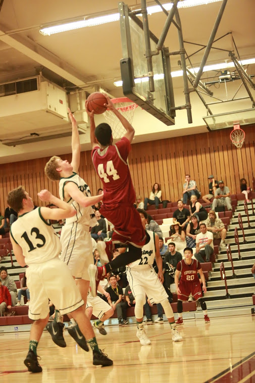 Senior Ajaypal Singh (44) rises to the basket for a contested layup.