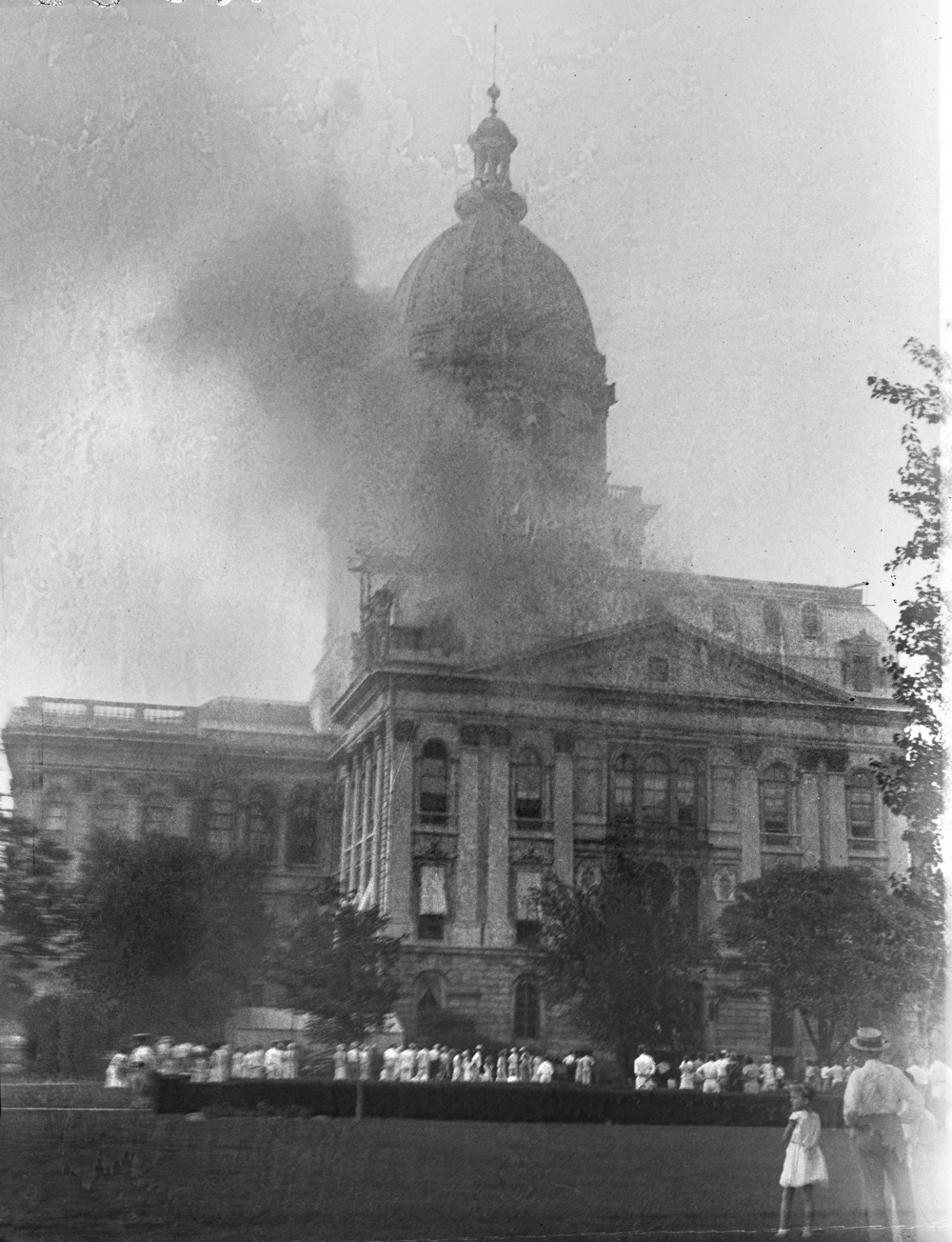 Thousands of spectators were drawn to the south lawn of the state Capitol grounds when fire broke out on Sunday July 9, 1933. File photos/The State Journal-Register
