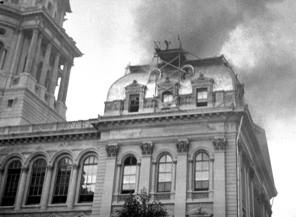 Smoke rises from the fifth floor of the south wing at the state Capitol July 9, 1933. At the time of the fire, roof repair work had been taking place.