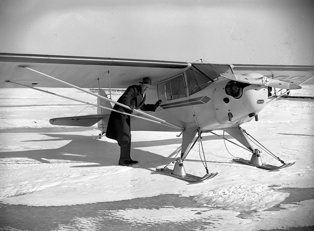 "How cold was it in January of 1940? It was so cold that you could have landed an airplane on the frozen surface of Lake Springfield, if you wanted to. Craig Isbell, co-manager of the Springfield Aviation Co. flying school, apparently wanted to. He told the Illinois State Journal that it was ""an experiment"" more than anything else because he was eager to see how his plane, a Taylorcraft fitted with skis, would handle on the ice. Isbell landed near Lindsay Bridge in front of the beach house. When ice conditions permitted it, city crews cleared the snow and smoothed the ice in the swimming area, and it was transformed into a popular skating site. Isbell provided rides to a lucky few.The paper said it was the perfect way to combine the fun of ice skating and flying at the same time. Published Jan. 25, 2015. File/ The State Journal-Register"
