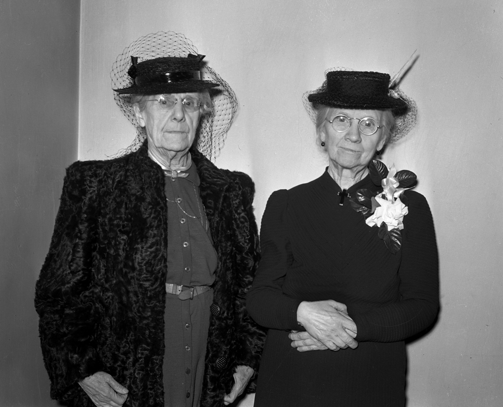 "Mrs. R.F. Herndon, left, told a fib. Herndon was a civic leader from the early days of Springfield and the widow of the founder of R.F. Herndon's and Co. clothing store, a longtime downtown retail anchor. Just before the store closed one Saturday afternoon in March 1940, Mrs. Herndon told Maggie Hickey, a store clerk, that she needed assistance in searching for a new Easter hat. In fact, it was only meant to stall Hickey from leaving the store. When Mrs. Herndon finally said she was finished and the two walked downstairs together, it was then that the surprise for Hickey was revealed. As a teenage girl in 1880, Hickey had applied for a job ""so she could help out with expenses"" at home. On that Saturday afternoon, the store's 80 employees and staff had gathered to congratulate her on 60 years of service. They stood around her at a table filled with gifts, cake, punch and miniature reproductions of the current and past Herndon's stores. ""They are pure gold,"" Hickey said of the Herndons. ""No one could have been lovelier to me."" Published March 8, 2014. File/ The State Journal-Register"