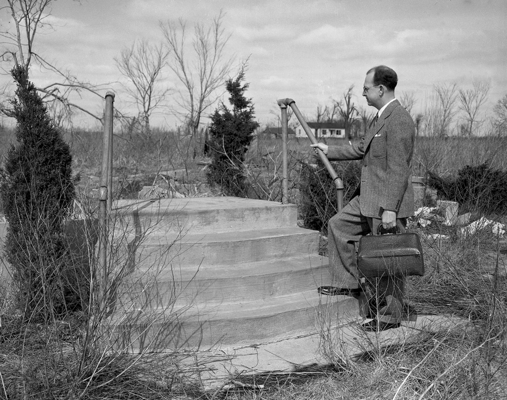 On a sunny spring day in March 1949, Dr. George Hess paused on the steps of what once was the Vroman family home in the Macoupin County community of Bunker Hill. A year earlier, on March 19, 1948, a devastating tornado swept through the town and destroyed almost every structure; only two buildings were left standing. It killed 19 people and injured 126. Hess, a physician in the community, had been the Vromans' doctor. But on the day of the tornado, there was little he could do to help. The storm claimed the lives of James Vroman, his wife, Norma, and two of their children, Danny and Carolyn Sue. Their infant daughter, Myra Jane, survived and was raised by an aunt in southern Illinois. Published March 15, 2014. File/ The State Journal-Register
