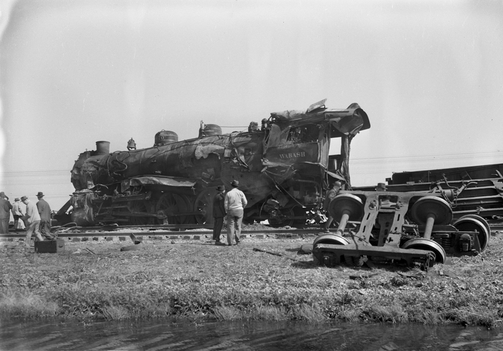 One person was killed and several injured when a Wabash Railroad passenger train left the tracks April 8, 1945, about 6 miles south of Taylorville. Investigators said a switch that had been left in the open position caused the locomotive to turn on its side, ripping apart its coal tender and sending three passenger coaches into the ditch. A diner car at the end of the train was the only one to stay upright on the rails. The locomotive's fireman was killed instantly by steam escaping from the boiler. The engineer also was severely burned and hospitalized in Taylorville. Authorities said the northbound train was running on the southbound tracks at the time of the incident because a freight train had derailed earlier farther south on the same line. The switch had been inadvertently left in the wrong position, they said. The Illinois State Journal reported that hundreds of people lined Illinois 48 to view the cleanup, which began almost immediately after the crash. Published March 29, 2014. File/ The State Journal-Register