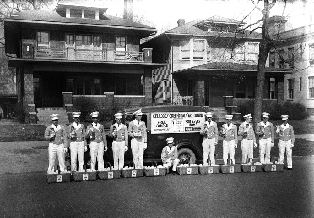 "Representatives of Kellogg Co. dressed in green coats, white trousers, hats and gloves distributed samples of the company's Pep cereal door to door in the 900 block of South Sixth Street 80 years ago today. Pep was a whole wheat, ready-to-eat breakfast cereal similar to Wheaties, which was its main rival in the market. The company infused the product with vitamins beginning in 1930, making it the first to be ""fortified."" Kellogg promoted the product heavily through sample giveaways, advertisements and, for years, sponsorship of Mutual Radio's "" The Adventures of Superman"" radio series. Just like many of today's cereals, it had promotional ties to figures in popular culture. In 1928, the cover of the package featured characters from "" The Little Rascals,"" a series of comedy short films popular at the time. Production of Pep ended in the late 1970s. Published April 19, 2014. File/ The State Journal-Register"