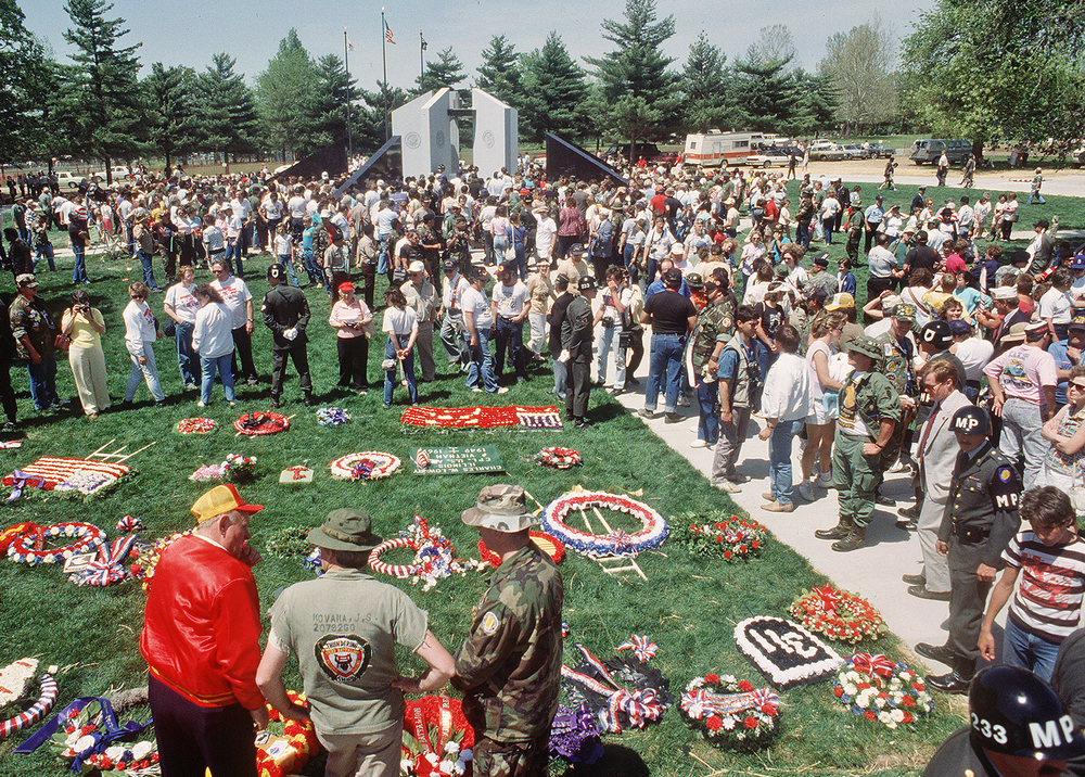 "Twenty-six years ago this week, the Illinois Vietnam Veterans Memorial in Oak Ridge Cemetery was dedicated. It was only 13 years after Saigon fell, ending U.S. involvement in the war. Ennis and Frances Tunison of White Hall were there to find the name of their only son, George Robert ""Bobby"" Tunison. A sniper had killed Bobby in 1968, one of the 2,998 soldiers from Illinois who died during the war. They found his name at the very bottom of one of the five black granite walls, too low for Ennis, 89, to reach. He and Frances held hands and just gazed at Bobby's name before they slowly walked away. Reflecting on the dedication ceremony, they told the newspaper, ""It's quite an honor to be present today. We find that we are not alone in this."" Today at 11 a.m., the Illinois Veteran Memorial Vigil Organization begins a 24-hour vigil at the memorial. At 6 p.m., a special ceremony will be held for the 66 men from Illinois still listed as prisoners of war or missing in action. The memorial will remain open overnight; the closing ceremony is scheduled for 11 a.m. Sunday. Published May 3, 2014. File/ The State Journal-Register"