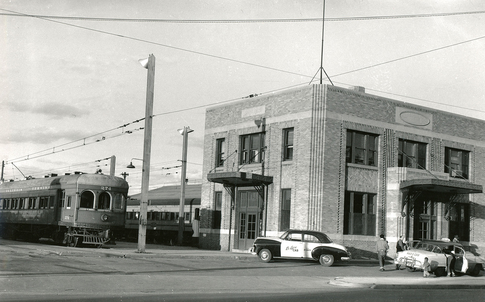In the early 1900s, the Illinois Terminal Railroad used streetcar tracks throughout the city to reach its downtown station at Eighth and Monroe streets (that old station is now Saputo's Restaurant). The railroad offered interurban passenger service throughout central and southern Illinois. But once buses arrived on the scene around 1930, the city wanted the trains gone and the railroad was forced to move east of downtown. It built a new passenger station at 2015 Clear Lake Ave., which opened in February 1933. The first floor had a ticket office, baggage/express window, waiting room and lunch counter. Offices occupied the second floor. The last train departed the station in March 1956 and the building was sold a few years later to the Henson Robinson Company, which made it their headquarters until 2003. They still own and use the property, however, the former Illinois Terminal passenger station soon will be gone. Its roof leaks and it's structurally unsound. Repairing it is cost prohibitive, according to Henson Robinson CFO Steve Etheridge, who added the building has been scheduled for demolition for a couple weeks and may come down as soon as today. This photo of the station in October 1954 and its history was provided by Dale Jenkins, president of the Illinois Traction Society.