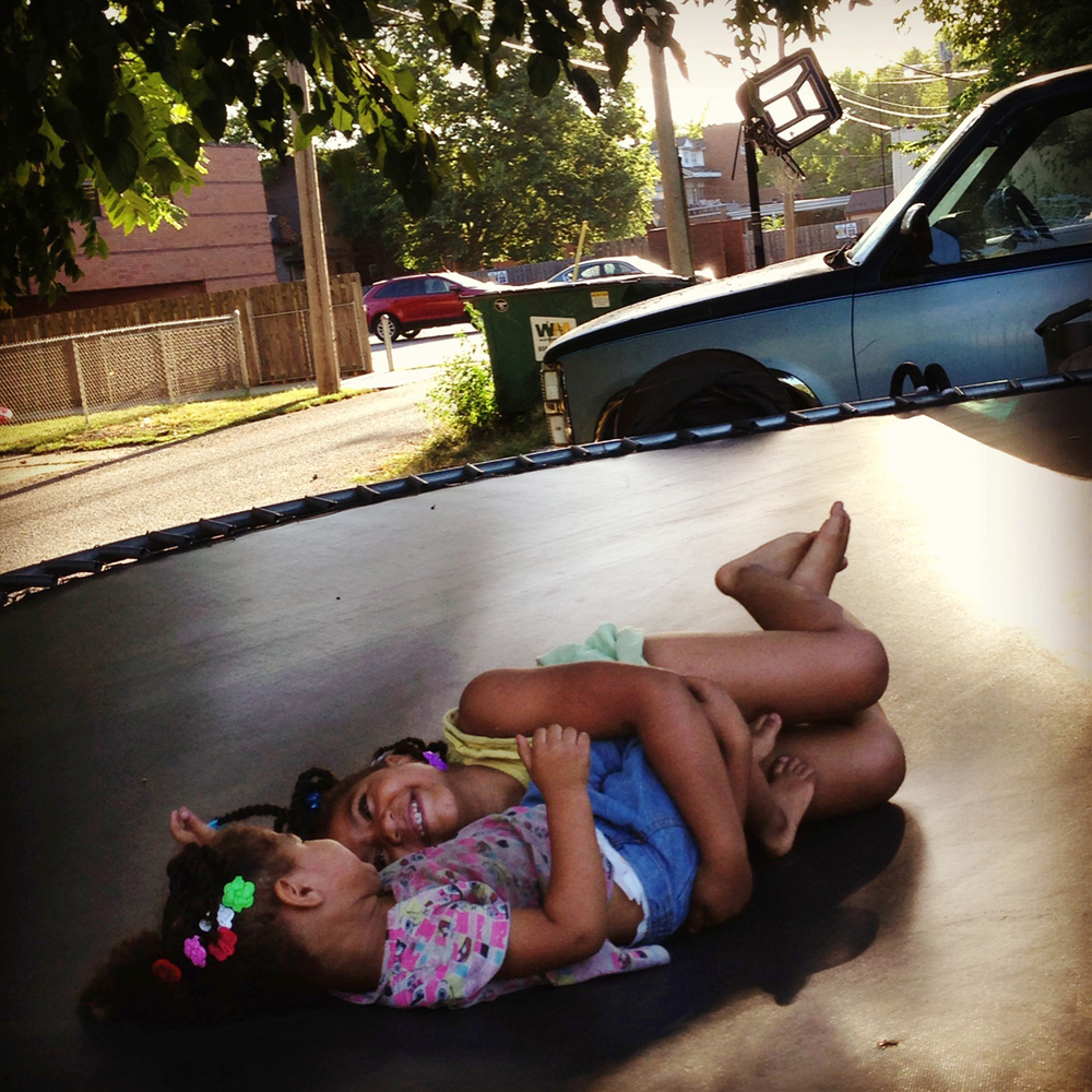 Leniyah and Airianna are sisters. In the backyard of their home Thursday, they played together on a trampoline.  #frommybike