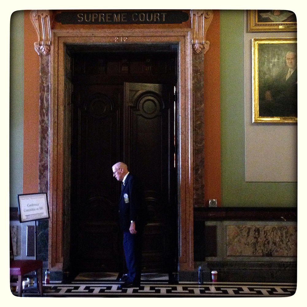 Paul Nevitt, Illinois Senate doorkeeper, outside pension committee hearing, old Supreme Court room.