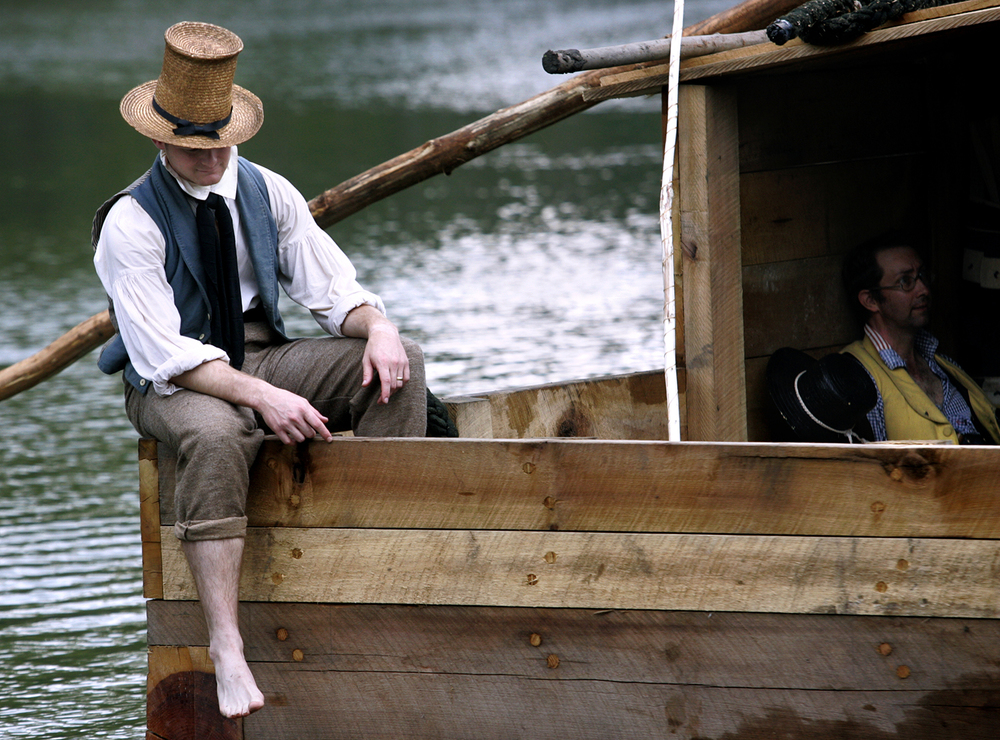 Paul Golladay of Springfield, left, and Joe Kleffman of Marquette Heights were among the re-enactors on a flatboat during a special event to celebrate Abraham Lincoln's arrival 175 years ago on the banks of the Sangamon River near the saw and grist mill at Lincoln's New Salem State Historic Site. Kendra Helmer/The State Journal-Register