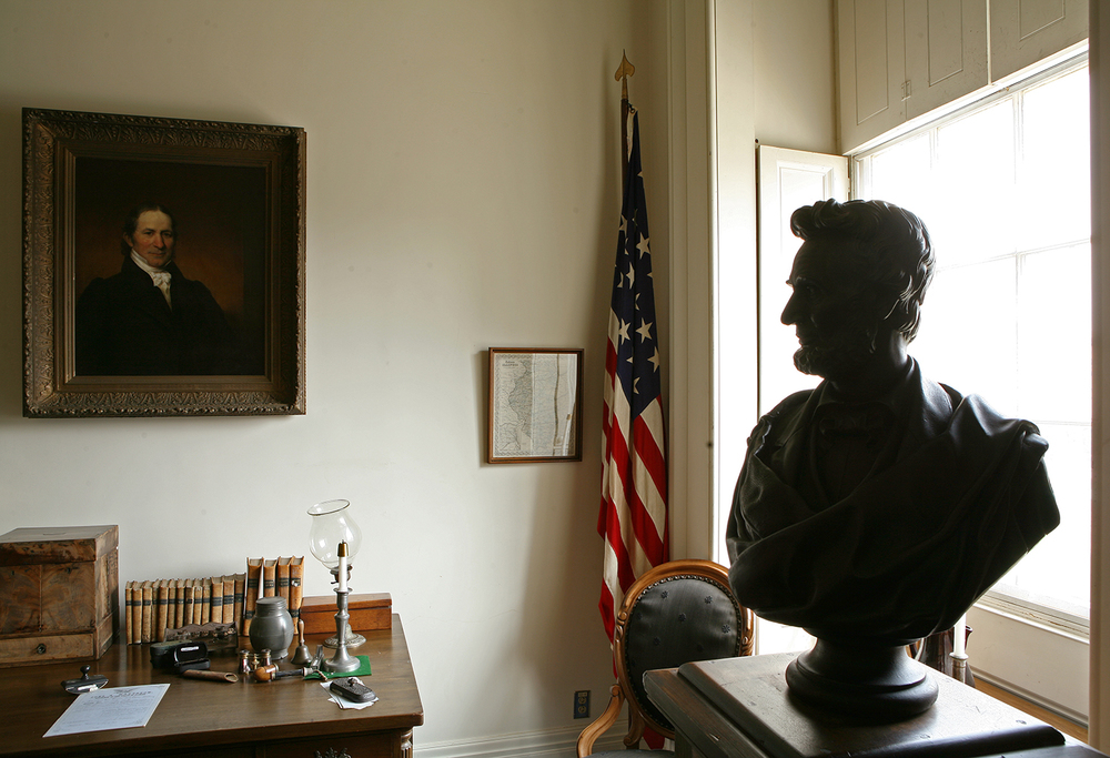 Lincoln sat for sculptor Tom Jones in 1860 at the St. Nicholas Hotel in Springfield. A reproduction of the bust by Jones is featured in the governor's office at the Old State Capitol. A portrait of Shadrach Bond, Illinois' first governor, hangs over the desk. Rich Saal/The State Journal-Register
