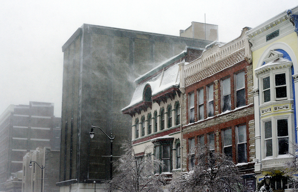 Snow blows off buildings on Sixth Street  during winter storm, December 2006. Kendra Helmer/The State Journal-Register