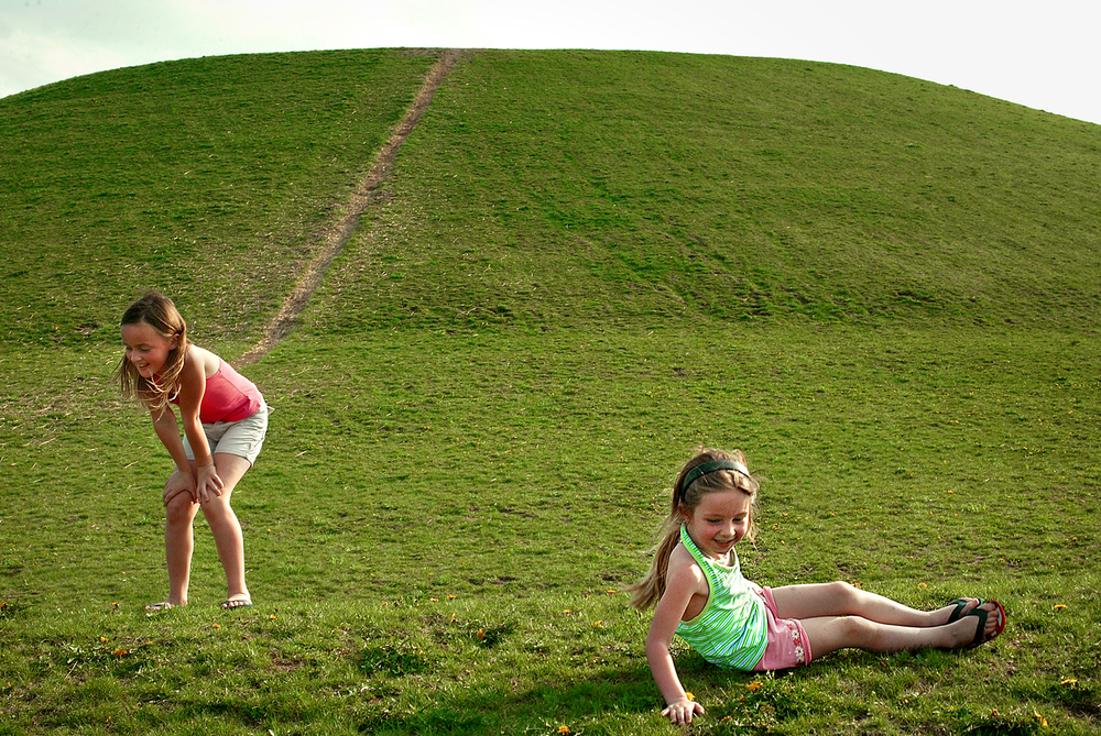 "Eight-year-old Lauren Harney catches her breath after conquering the sledding hill and rolling back down with her sister Sidney, 4, at Centennial Park, Friday, April, 14, 2006. The two girls visited the park with parents Tim and Carla Harney, who both took off of work to spend time with their daughters who are on Spring Break from School. ""We had the bestest day ever,"" Sidney added. David Albers/The State Journal-Register"