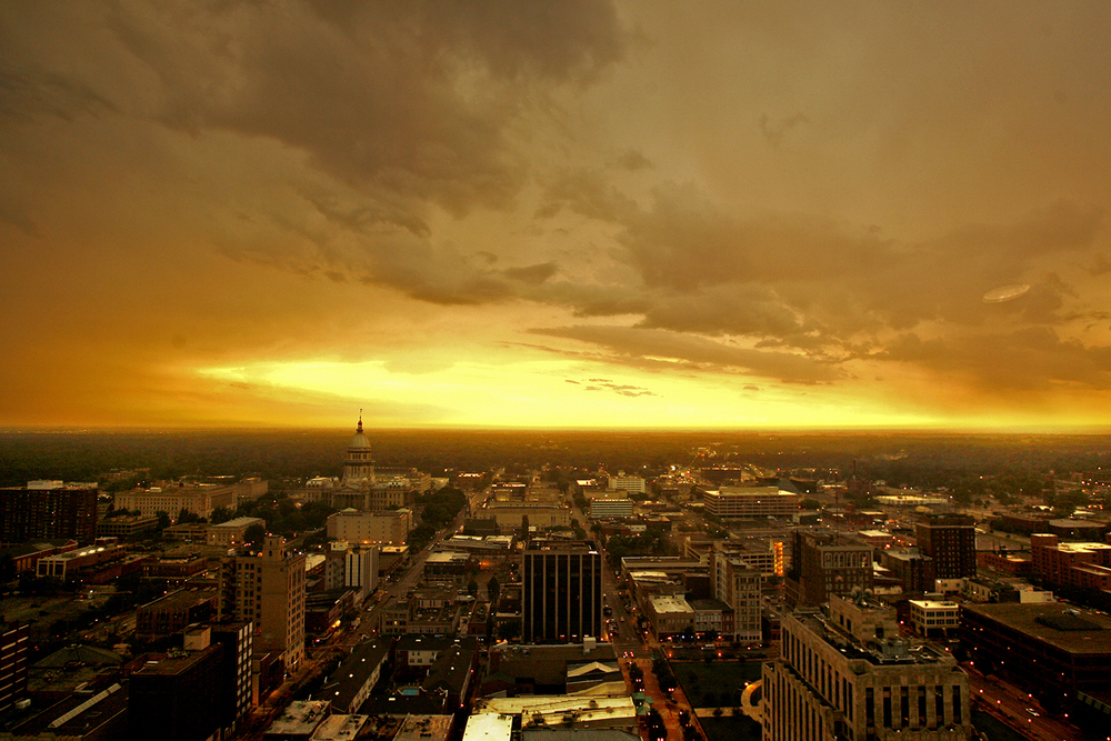 Storm clouds clear out to the west as the sun sets over downtown Springfield after a series of storms moved through the area. Justin L. Fowler/State Journal-Register