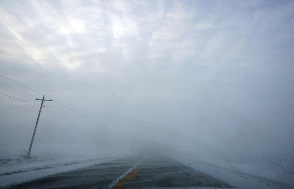 Blowing snow made driving difficult on Illinois Route 124 south of Williamsville Sunday, Dec. 12, 2010. Ted Schurter/The State Journal-Register