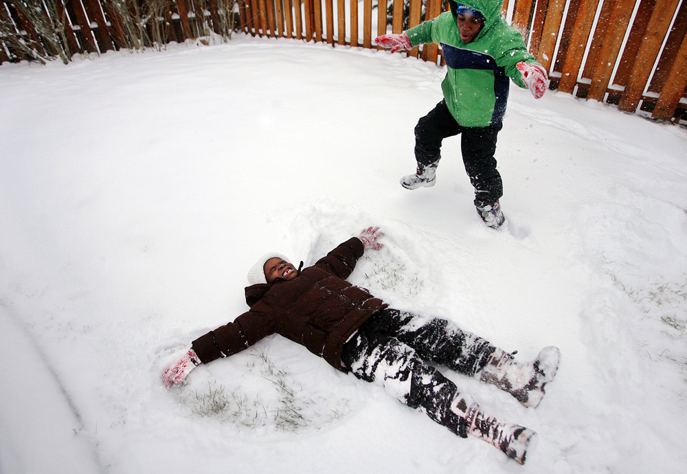 Six-year-old twins Angela and Angelo Hurtubise play in the snow Tuesday, Jan. 11, 2011. The two are adapting well to life in the U.S. after being adopted by Mike and Sandy Hurtubise in early 2010. Ted Schurter/The State Journal-Register