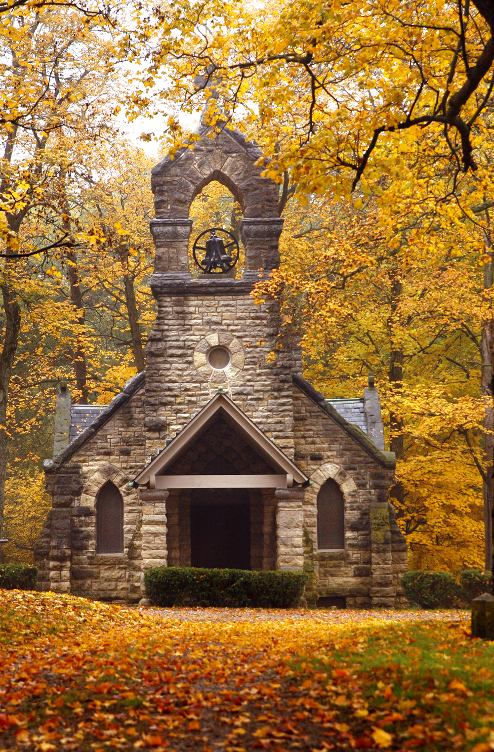 Colorful fall foilage envelopes St. John The Baptist Chapel on Elkhart Hill Wednesday, Oct. 30, 2013. The Gothic revival-style chapel, built mostly with limestone blocks by the Culver Stone and Marble Co. of Springfield for about $10,000 in 1890, is the only privately owned and operated church in Illinois. Ted Schurter/The State Journal-Register