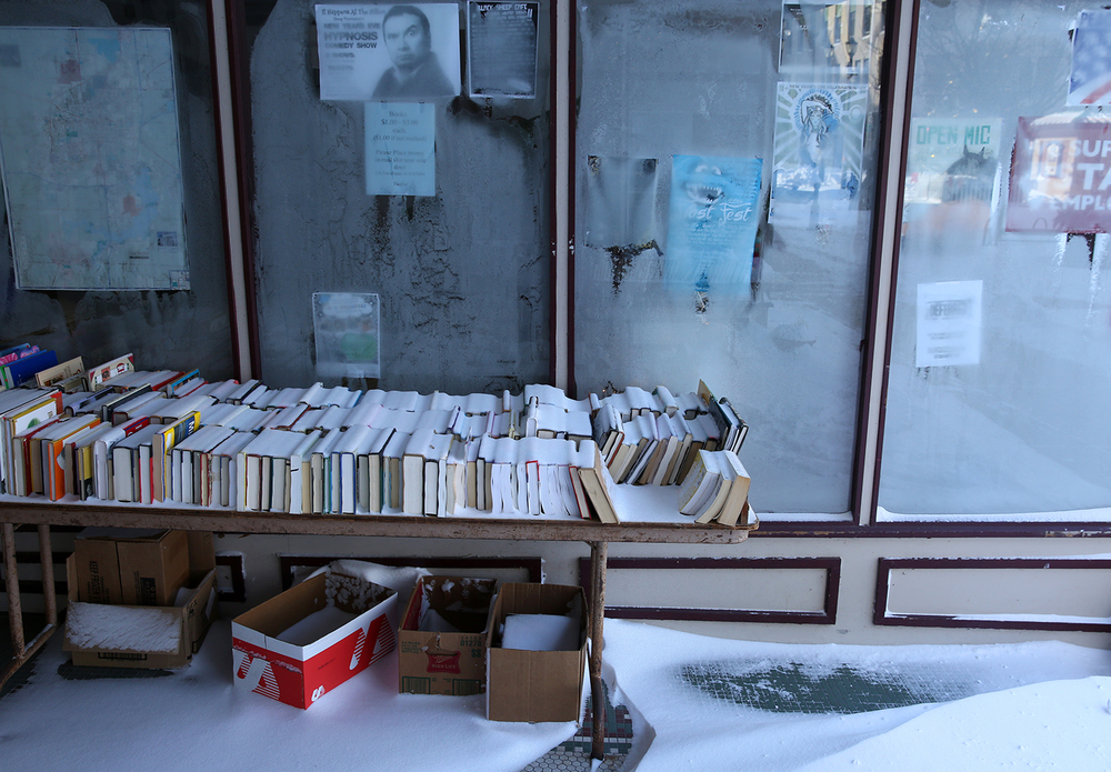 Snow collected on books that were on a table outside Prairie Archives bookstore on the Old Capitol Plaza Monday, Jan. 6, 2014. Rich Saal/The State Journal-Register