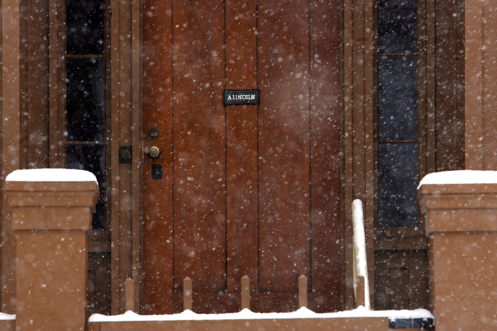 Snow begins to pile up on the fence surrounding the Springfield home of Abraham Lincoln at the The Lincoln Home National Historic Site Thursday, Feb. 21, 2013. Ted Schurter/The State Journal-Register
