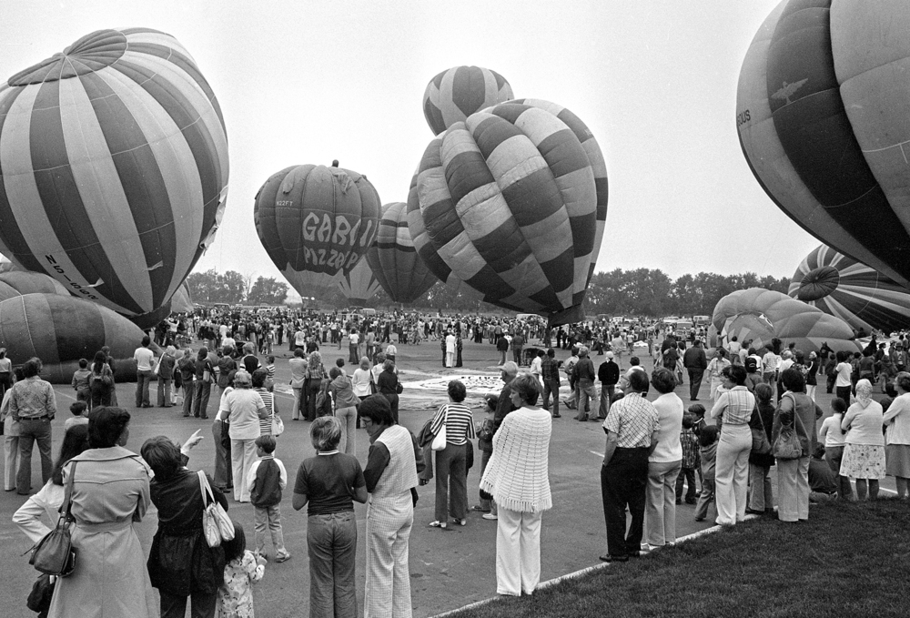 The marketing manager for the mall estimated the crowd size for the grand opening at 10,000, with many arriving before the 8 a.m. celebrity hot air balloon race.