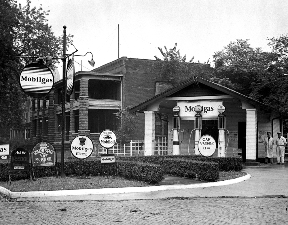 Mobilgas station, Monroe and New streets, circa 1930. The outline of the State Capitol dome is partially visible behind the sign, upper left.