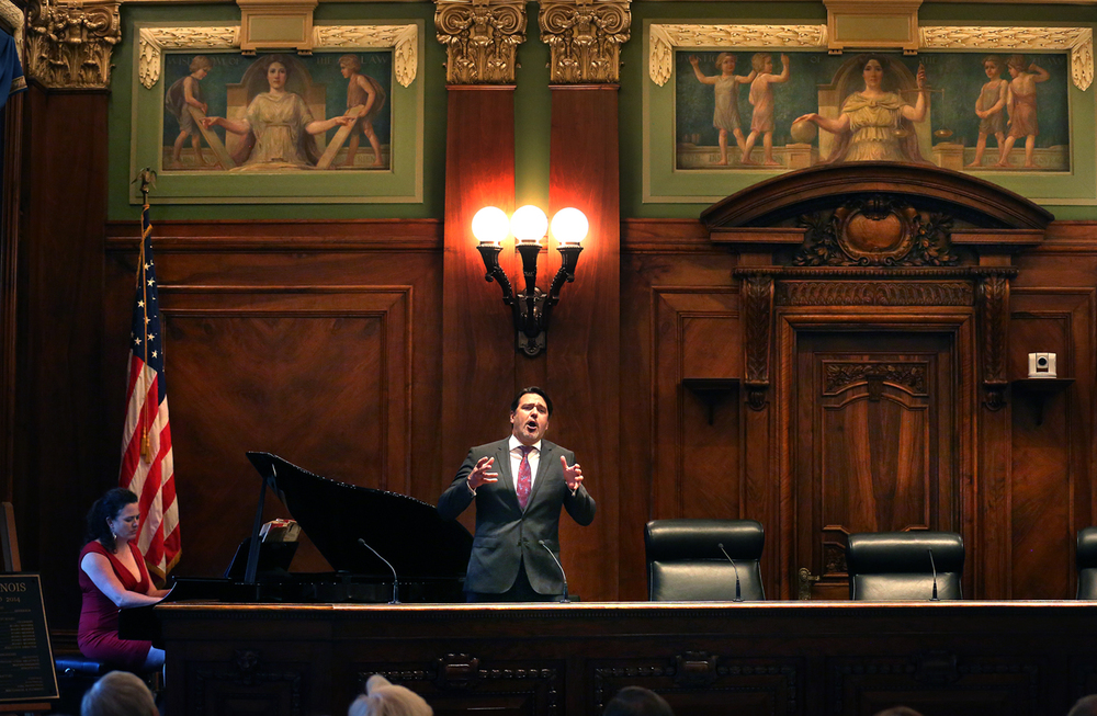 "Nathan Gunn, an internationally renowned opera singer, professor of voice at the University of Illinois at Champaign-Urbana and grandson of Walter Gunn, the 70th Justice of the Illinois Supreme Court from 1938-1951, sings ""Brother, Can you spare a Dime?"" in the same courtroom his great-grandfather presided in on Monday evening as part of the re-dedication ceremony. Gunn was accompanied by his wife Julie Jordan Gunn, on piano.  After a one-year renovation, the Illinois Supreme Court building in Springfield was officially re-dedicated by dignitaries including Chief Justice Rita Garman, Supreme Court Historic Preservation Commission chairman and former Ill Governor Jim Thompson and Illinois State Bar Association president Richard Felice on Tuesday evening, Oct. 7, 2014. David Spencer/The State Journal-Register"