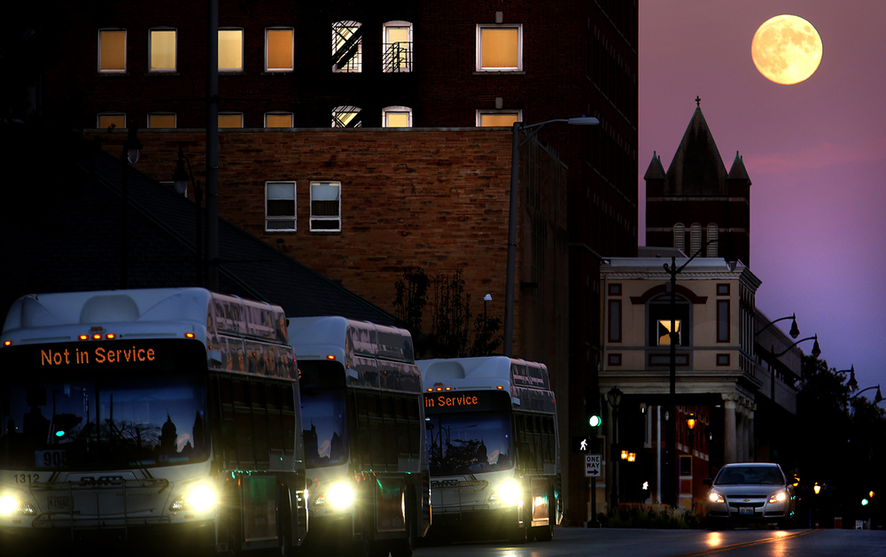 A full moon rises Tuesday evening, Oct. 7, 2014 over Capitol Avenue. Later that night, the moon went into a full eclipse, the second of the year. David Spencer/The State Journal-Register