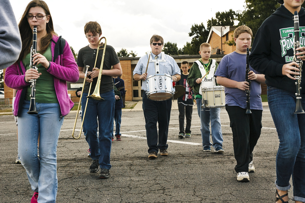 Brett Burchard leads marching band practice at Jonathan Turner Junior High School in Jacksonville Monday, Oct. 6, 2014. District 117 superintendent Steve Ptacek believes a one-cent sales tax would raise enough money for building improvements that would allow the consolidation of sixth grade students at the junior high building and enable them to participate in music class. Ted Schurter/The State Journal-Register