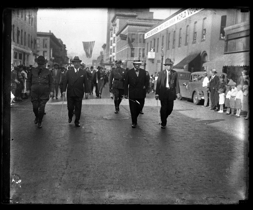 Parade in support of National Recovery Act, Fourth Street facing north from Adams Street. St. Nicholas Hotel in background. From left, Col. John M. Tipton, grand marshal, Gov. Henry Horner, Speaker of the House Henry T. Rainey of Carrollton, and Commander Charles E. Jones of the department of Alabama, Grand Army of the Republic, Oct. 5, 1933,  File/The State Journal-Register.