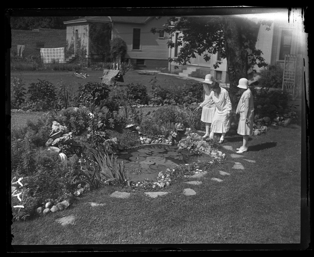 Springfield Garden Club members inspecting backyard garden at 711 South Glenwood, July 25, 1929. Mrs. O.J. DeSale, Mrs. Fred Kincaid, and Mrs. Henry Helmle. File/The State Journal-Register.