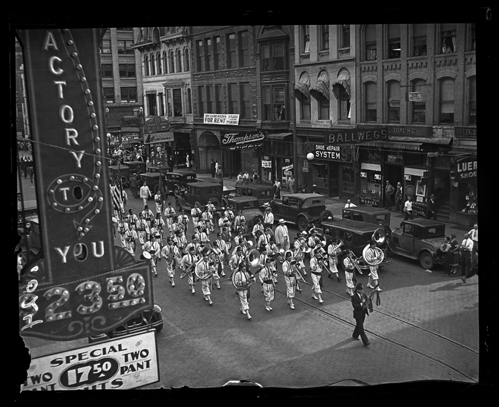 Shriner's Band marching in parade on Sixth Street between Adams and Monroe streets looking south, Ferguson Building in background, circa 1933. File/The State Journal-Register