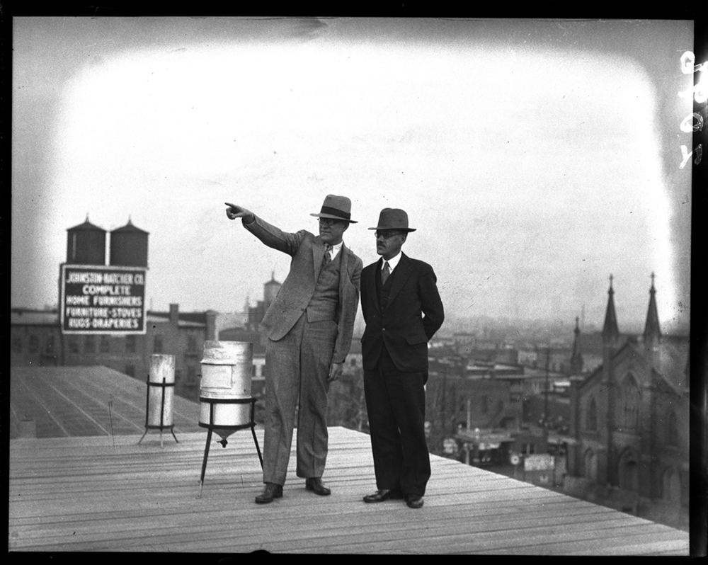 W. F. Feldwish and Elward Holcomb, the new manager of the local weather bureau, during a trip to the roof of the federal building where weather monitoring equipment was kept, Nov. 7, 1932. File/The State Journal-Register.