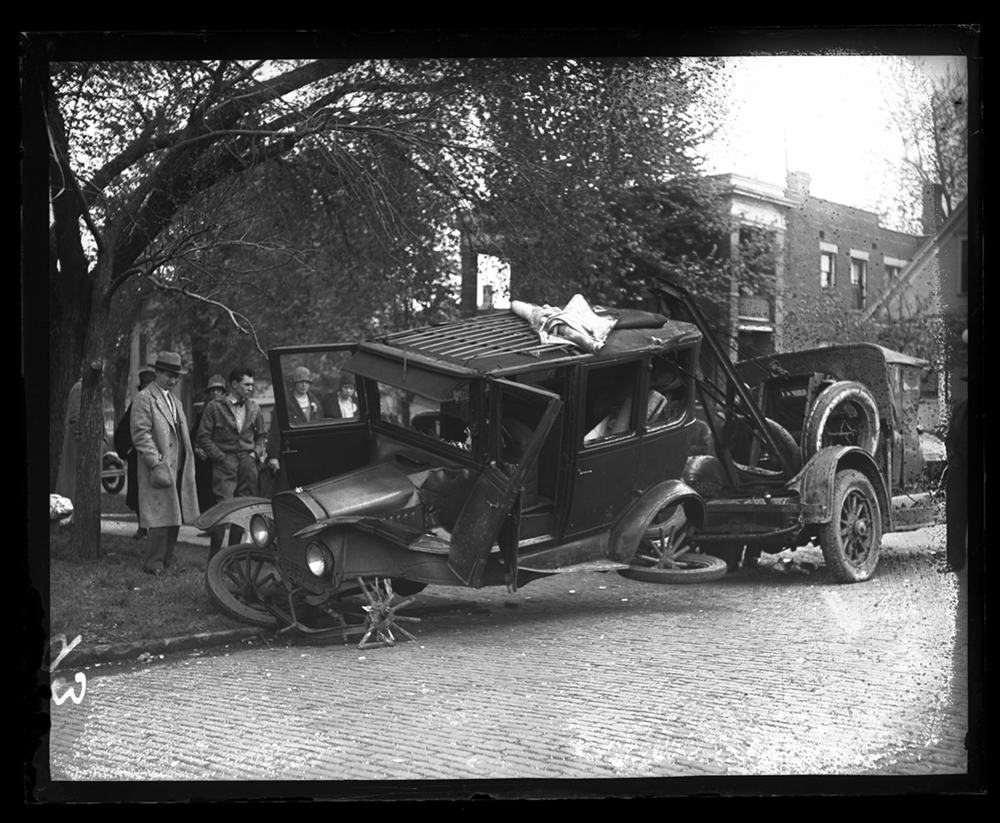 Damaged auto hooked to tow truck, circa 1931. File/The State Journal-Register