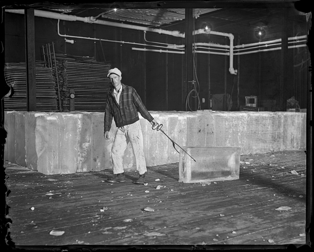 Clark Frisbie pulling ice block in the ice storage room at the C.I.P.S. ice house at 10th and Edward streets, July 12, 1936. File/The State Journal-Register