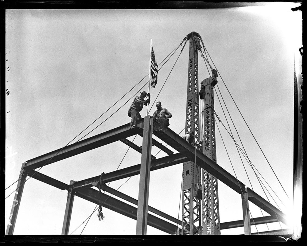 Ironworkers E. Gable, left, and Johnnie Gentry top off the C.I.P.S. building at the highest point of structural steel, July 26, 1930. File/The State Journal-Register