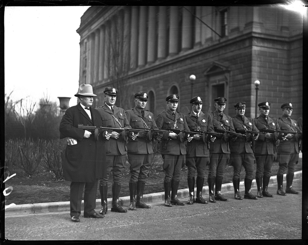 The Illinois State Police purchased new Thompson submachine guns to help them face the threats of the day, which included bootleggers and labor unrest that frequently turned violent. The guns were issued to every sergeant in each police district throughout the state. Capt. Carr, assistant superintendent of highway police, left, posed with his officers and their guns in front of the Centennial Building on February 28, 1931. File/The State Journal-Register