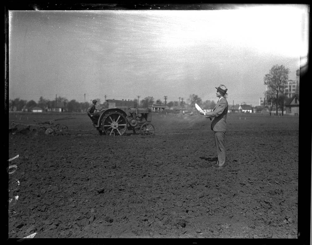 Frank Dillion, Y.M.C.A. secretary, oversees preparation of garden plot for unemployed near C&IM railroad at 19th Street and Moffat Avenue, April 19, 1931. Operating the tractor is James Holzwort. File/The State Journal-Register.